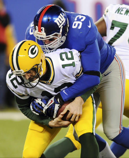 New York Giants middle linebacker Chase Blackburn (93) sacks Green Bay Packers quarterback Aaron Rodgers (12) during the first half of an NFL football game, Sunday, Nov. 25, 2012, in East Rutherford, N.J. (AP Photo/Bill Kostroun)