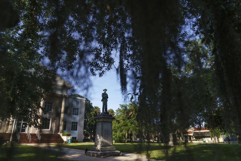 A Confederate statue stands outside the Putnam County Courthouse in Palatka, Fla., Tuesday, April 13, 2021. In the 1920s, Jim Crow Florida was one of the most dangerous places in the South to be Black. (AP Photo/David Goldman)