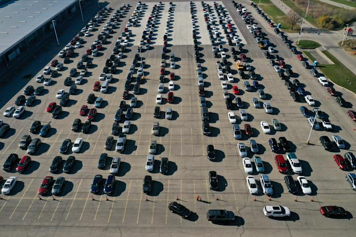 An aerial view of vehicles queuing at a drive-thru COVID-19 testing site at the Alliant Energy Center complex, as the coronavirus disease outbreak continues in Madison, Dane County, Wisconsin, U.S., November 5, 2020. (Bing Guan/Reuters)