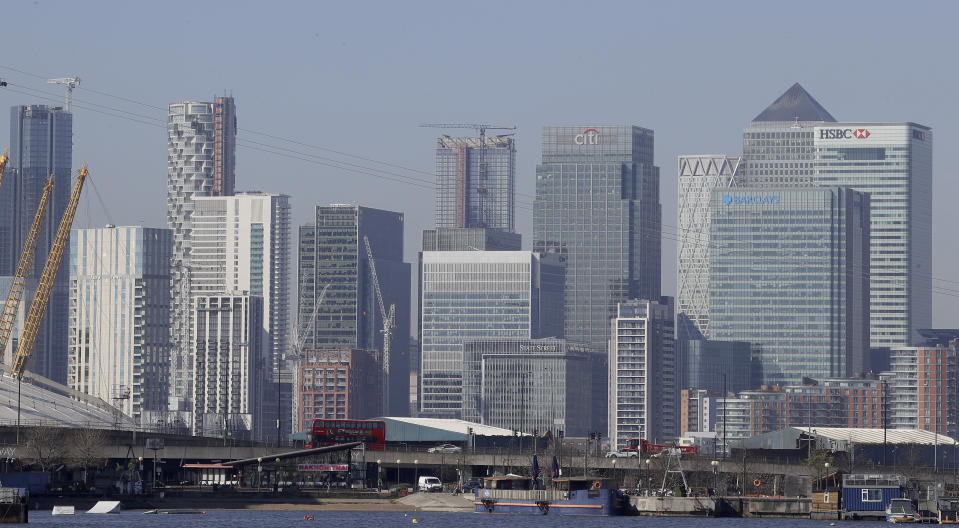 London's financial district in Canary Wharf, London, Wednesday, March 25, 2020. The new coronavirus causes mild or moderate symptoms for most people, but for some, especially older adults and people with existing health problems, it can cause more severe illness or death.(AP Photo/Kirsty Wigglesworth)