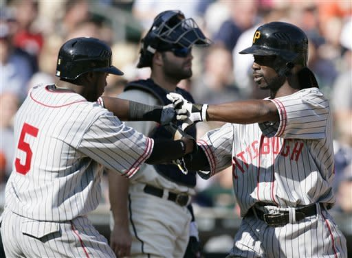 Pittsburgh Pirates' Andrew McCutchen, right, celebrates his two-run home run with Josh Harrison (5) in the fifth inning of an interleague baseball game against the Detroit Tigers, Saturday, May 19, 2012, in Detroit. (AP Photo/Duane Burleson)