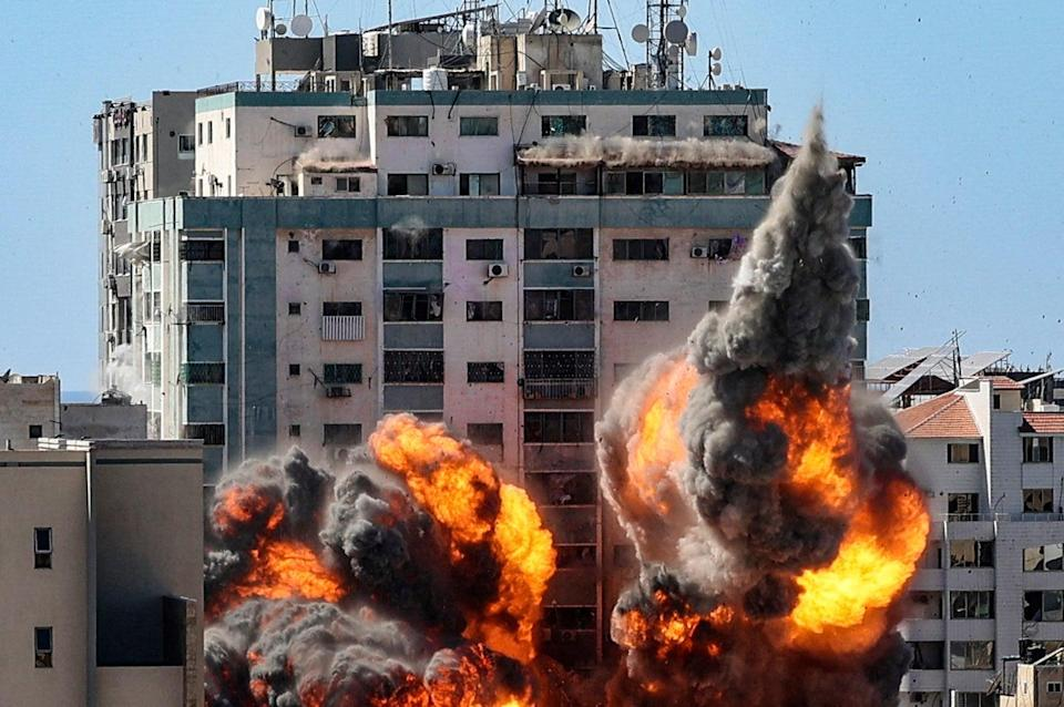 The moment an Israeli airstrike hit the al Jaala tower in Gaza City (AFP via Getty Images)