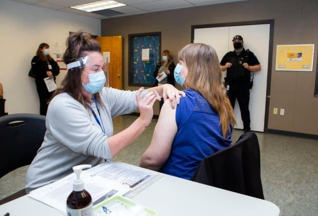 A health worker administers a vaccine on Vancouver Island at a clinic in January 2021.