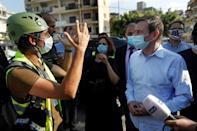 The top US career diplomat David Hale talks with young volunteers in a hard-hit neighbourhood of Beirut, bypassing the politicians many Lebanese blame for the disaster