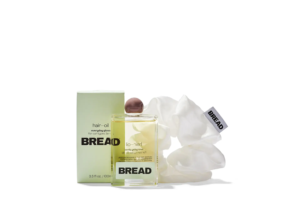 """<h3>Bread Favorites-Duo</h3><br>Bread delivers """"hair care basics for not basic hair"""" with its critically-acclaimed selection of everything from glossy serums to conditioning masks and gentle shampoos all formulated specifically for 3a to 4c hair textures. This duo of everyday glossy hair oil and bread-puff hair scrunchie would make the perfect gift for any curly girl in your life. For additional amazing Black-Owned and female-founded businesses to support during the holiday season and year-round, we recommend checking out <a href=""""https://www.refinery29.com/en-us/black-women-owned-businesses"""" rel=""""nofollow noopener"""" target=""""_blank"""" data-ylk=""""slk:this story"""" class=""""link rapid-noclick-resp"""">this story</a>.<br><br><strong>Bread</strong> Favorites-Duo, $, available at <a href=""""https://go.skimresources.com/?id=30283X879131&url=https%3A%2F%2Fwww.breadbeautysupply.com%2Fproducts%2Fhair-oil-bread-puff-duo%2F"""" rel=""""nofollow noopener"""" target=""""_blank"""" data-ylk=""""slk:Bread"""" class=""""link rapid-noclick-resp"""">Bread</a>"""