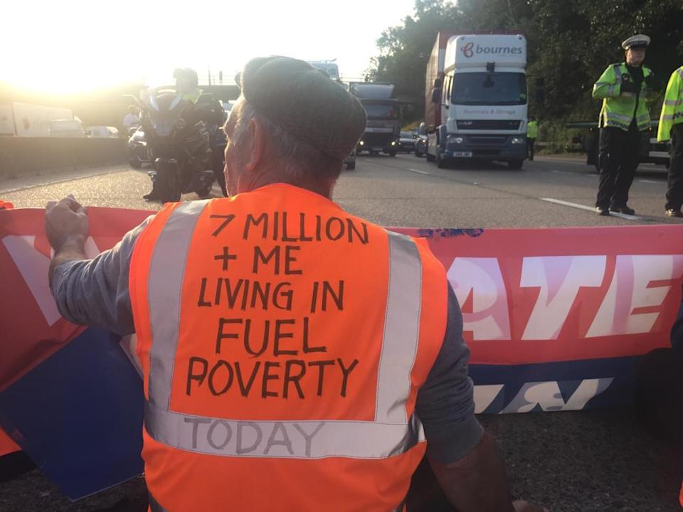 A protester sits in the road