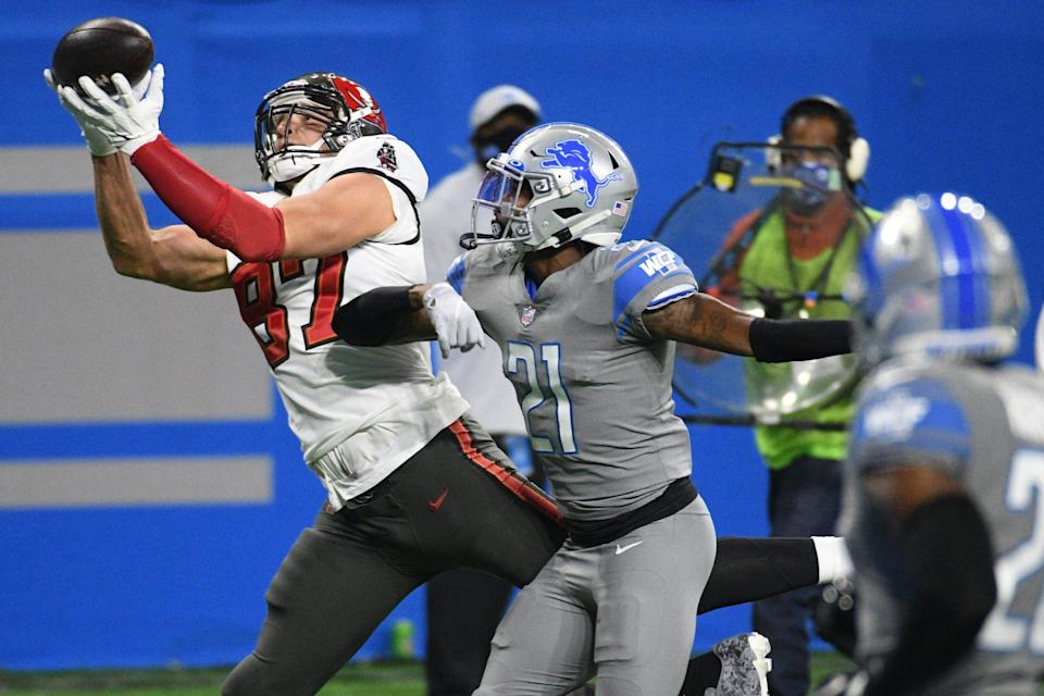 Tampa Bay Buccaneers tight end Rob Gronkowski catches a pass for a touchdown against Detroit Lions safety Tracy Walker during the first quarter at Ford Field, Dec. 26, 2020.