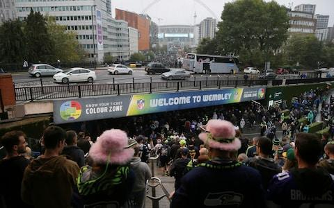 <span>Over here: London NFL fans are converging on Wembley eager to see the Oakland Raiders vs Seattle Seahawks</span> <span>Credit: AP Photo/Tim Ireland </span>