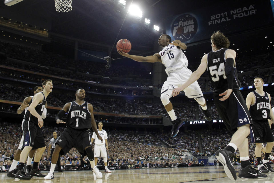 FILE- In this April 4, 2011, file photo, Connecticut's Kemba Walker (15) shoots against Butler during the second half of the men's NCAA Final Four college basketball championship game in Houston. Walker was selected as one of the top college basketball players of the decade.(AP Photo/Eric Gay, File)