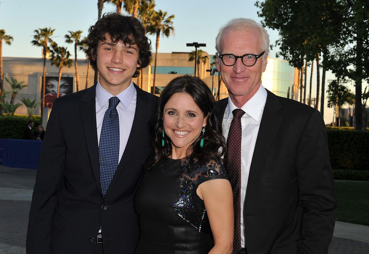 HOLLYWOOD, CA - APRIL 09:  Actress Julia Louis-Dreyfus (C) with son Charles Hall and husband Brad Hall as they attend the Los Angeles premiere for the second season of HBO's series 'Veep' at Paramount Studios on April 9, 2013 in Hollywood, California.  (Photo by Angela Weiss/Getty Images)