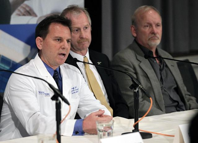 Dallas Stars medical services director Dr. Robert J. Dimeff, M.D., left, answers questions regarding forward Rich Peverley and the incident which occurred in a recent NHL game during a news conference at UT Southwestern Medical Center Wednesday, March 12, 2014, in Dallas, while Stars' general manager Bill Nill and coach Lindy Ruff, right, listen. (AP Photo/Tim Sharp)