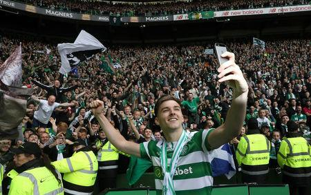 Celtic player Kieran Tierney takes a selfie at Celtic Park after the last match of the season against Heart of Midlothian, Glasgow, Scotland, Britain, May 21, 2017. Picture taken May 21, 2017 REUTERS/Paul Hackett