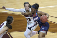Belmont's Destinee Wells (11) drives against Gonzaga's Cierra Walker (13) during the second half of a college basketball game in the first round of the NCAA women's tournament at University Events Center in San Marcos, Texas, Monday, March 22, 2021. (AP Photo/Chuck Burton)
