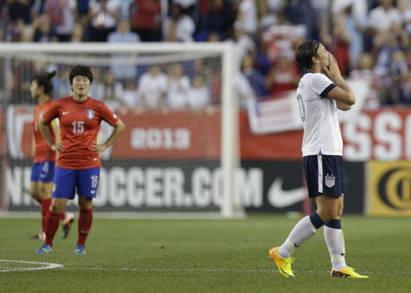 United States' Abby Wambach, right, reacts after scoring a goal against South Korea during the first half of an international friendly soccer match at Red Bull Arena, Thursday, June 20, 2013, in Harrison, N.J. With the goal, Wambach broke Mia Hamm's record for international career goals by a soccer player. (AP Photo/Julio Cortez)