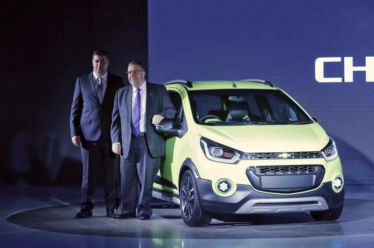 General Motors India President and Managing Director, Kaher Kazem (L) and Chief Marketing Officer Global Chevrolet, Tim Mahoney pose with a newly launched Beat Activ car at the Indian Auto Expo in Greater Noida, on the outskirts of New Delhi, India, February 3, 2016. REUTERS/Anindito Mukherjee