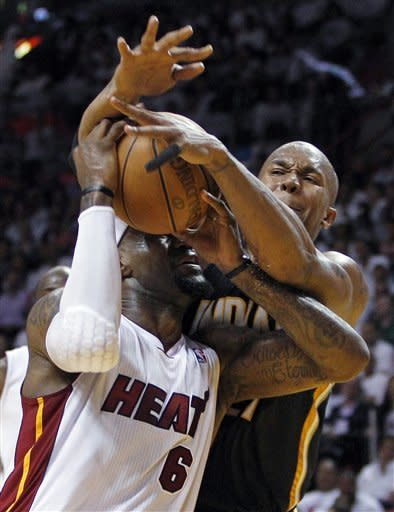 Miami Heat's LeBron James (6) is fouled by Indiana Pacers' David West, right, during the second half of Game 5 of an NBA basketball Eastern Conference semifinal playoff series, in Miami on Tuesday, May 22, 2012. The Heat defeated the Pacers 115-83. (AP Photo/Lynne Sladky)