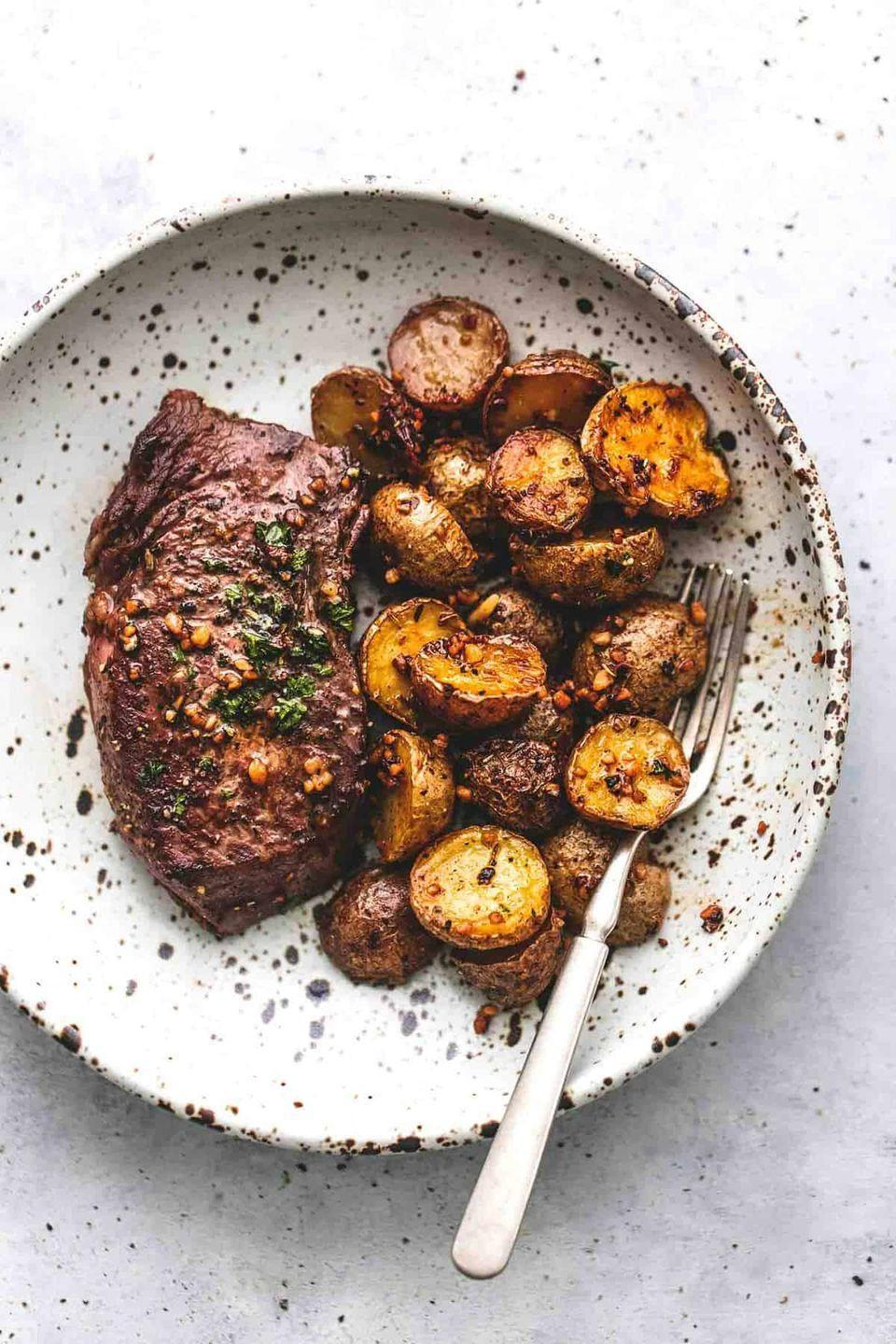 """<p>There's one thing better than a well-cooked steak and a side of crunchy potatoes: being able to say you cooked them both in one pan!</p><p><strong>Get the recipe at <a href=""""https://www.lecremedelacrumb.com/garlic-butter-steak-and-potatoes-skillet/"""" rel=""""nofollow noopener"""" target=""""_blank"""" data-ylk=""""slk:Creme de la Crumb"""" class=""""link rapid-noclick-resp"""">Creme de la Crumb</a>.</strong></p><p><a class=""""link rapid-noclick-resp"""" href=""""https://go.redirectingat.com?id=74968X1596630&url=https%3A%2F%2Fwww.walmart.com%2Fbrowse%2Fhome%2Fthe-pioneer-woman-dishes%2F4044_623679_639999_7373615&sref=https%3A%2F%2Fwww.thepioneerwoman.com%2Ffood-cooking%2Fmeals-menus%2Fg35191871%2Fsteak-dinner-recipes%2F"""" rel=""""nofollow noopener"""" target=""""_blank"""" data-ylk=""""slk:SHOP DISHES"""">SHOP DISHES</a><br></p>"""