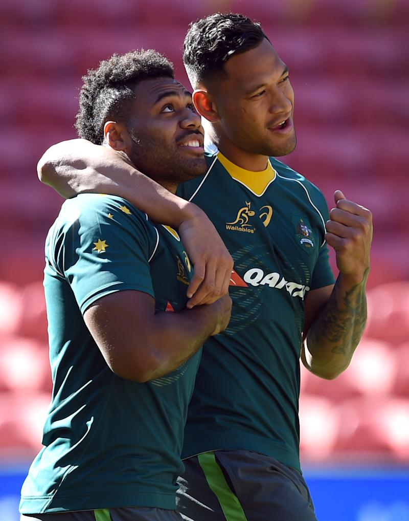 Samu Kerevi (pictured left) is embraced by Israel Folau (pictured right).