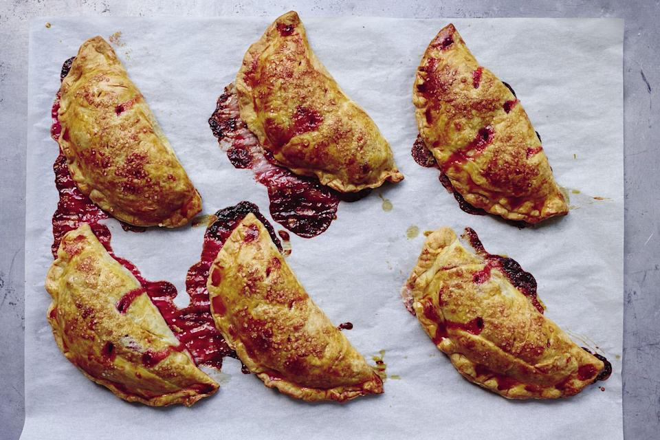"These simple hand pies are packed to the brim with tangy sweetened, ruby-hued <a href=""https://www.epicurious.com/ingredients/rhubarb-sweet-savory-recipes-gallery?mbid=synd_yahoo_rss"" rel=""nofollow noopener"" target=""_blank"" data-ylk=""slk:rhubarb"" class=""link rapid-noclick-resp"">rhubarb</a>. Once they've cooled, pack them up and take them on a picnic. <a href=""https://www.epicurious.com/recipes/food/views/rhubarb-turnovers?mbid=synd_yahoo_rss"" rel=""nofollow noopener"" target=""_blank"" data-ylk=""slk:See recipe."" class=""link rapid-noclick-resp"">See recipe.</a>"