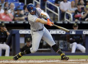 New York Mets' Pete Alonso hits a solo home run during the second inning of the team's baseball game against the Miami Marlins, Friday, May 17, 2019, in Miami. (AP Photo/Lynne Sladky)
