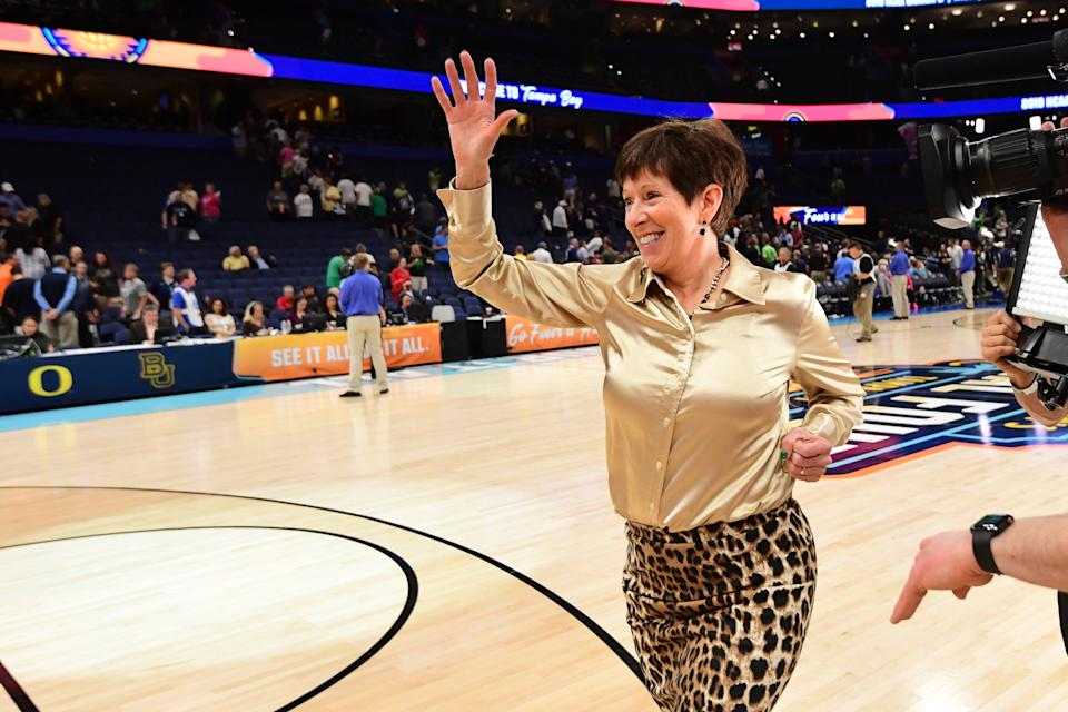 Muffet McGraw runs off the court at the Final Four.