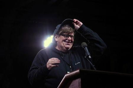 Michael Moore speaks at a protest against U.S. President Donald Trump outside the Trump International Hotel in New York City