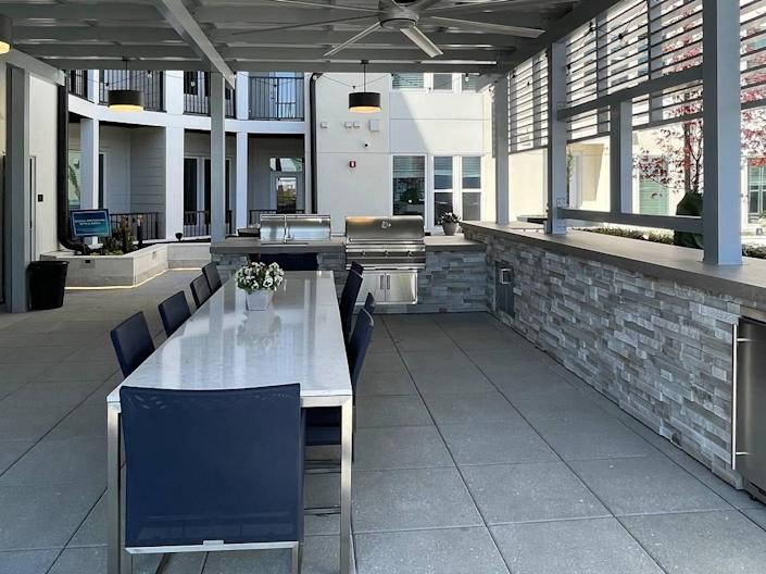 Grills are provided for outdoor relaxation at The Ellis.