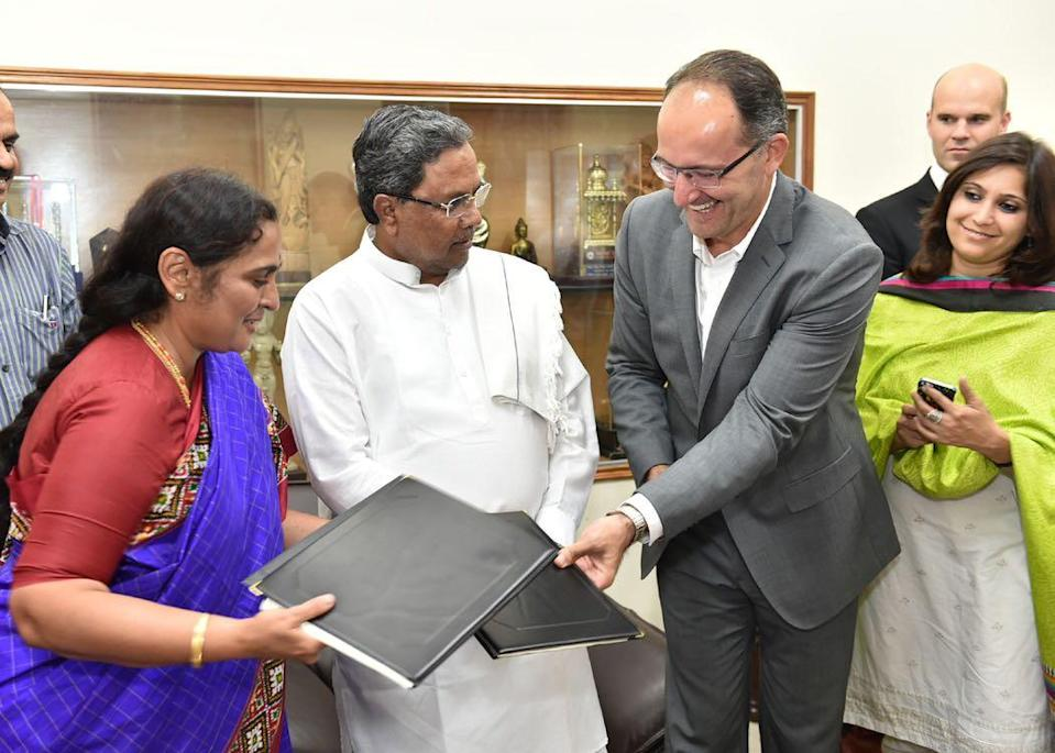 With C.M. Siddaramaiah. Signing of MOU wth Ikea.