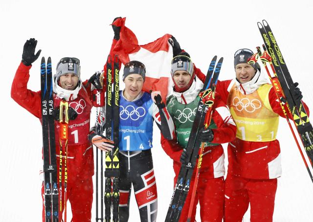 Nordic Combined Events - Pyeongchang 2018 Winter Olympics - Men's Team 4 x 5 km Final - Alpensia Cross-Country Skiing Centre - Pyeongchang, South Korea - February 22, 2018 - Bronze medallists Wilhelm Denifl, Lukas Klapfer, Bernhard Gruber and Mario Seidl of Austria celebrate. REUTERS/Dominic Ebenbichler