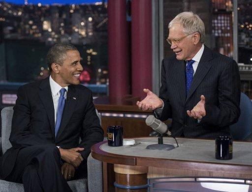 "US President Barack Obama and David Letterman speak during the ""Late Show with David Letterman"""