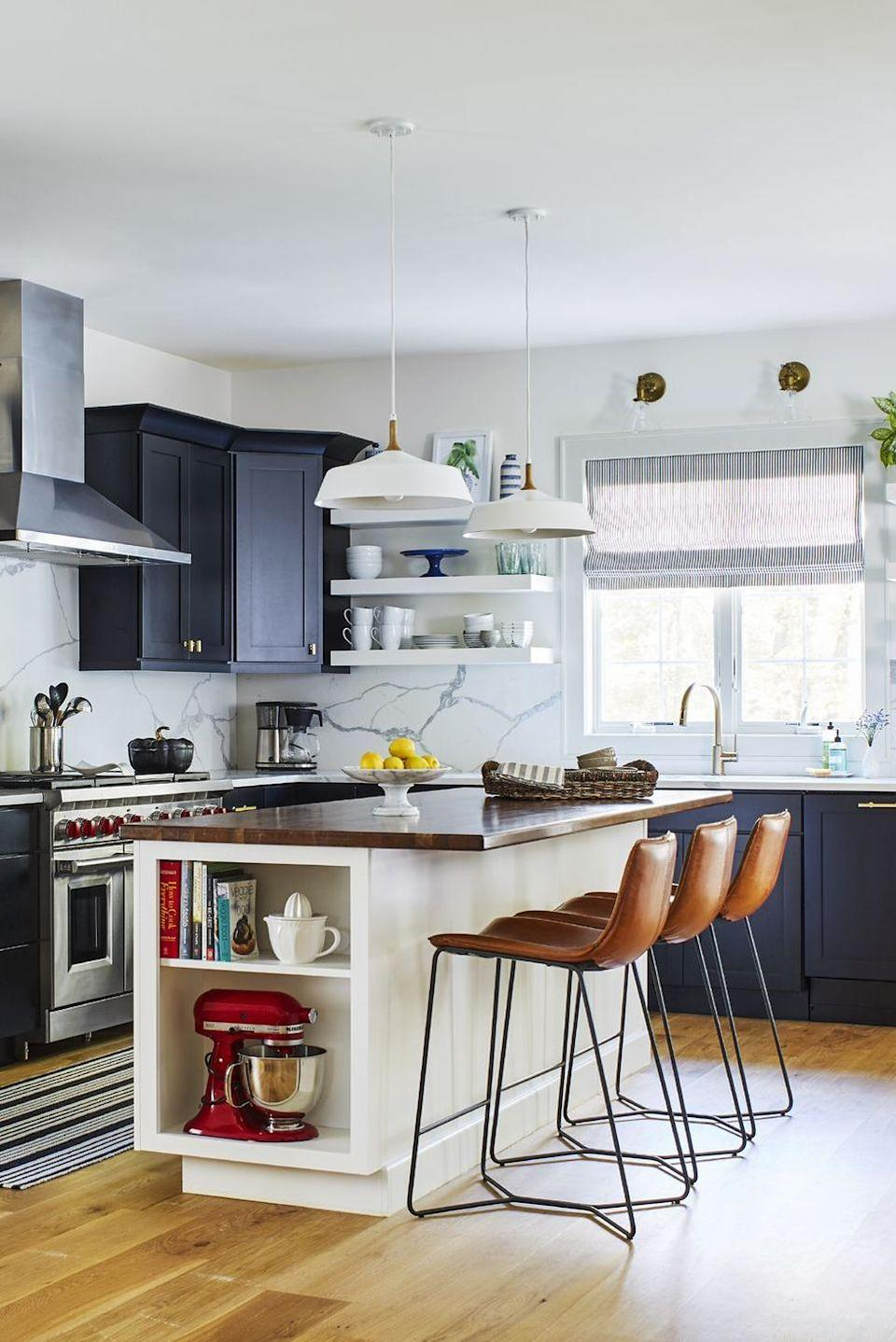 "<p>In chef <a href=""https://www.goodhousekeeping.com/beauty/fashion/g4337/katie-lee-summer-fashion-entertaining-recipes/"" rel=""nofollow noopener"" target=""_blank"" data-ylk=""slk:Katie Lee's"" class=""link rapid-noclick-resp"">Katie Lee's</a> Hamptons kitchen, a soft blue tile backsplash complements the white cabinets and the sunny view. </p>"