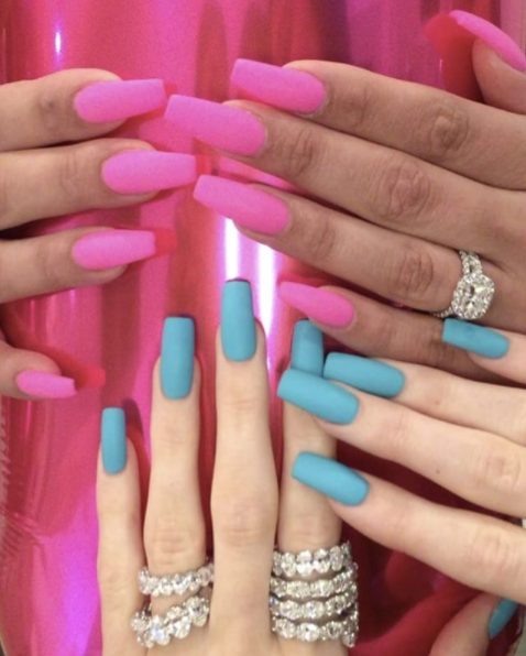 "<p>King Kylie and her friend Heather Sanders both got coffin nails — Kylie in light blue. Her mani is an exact match for <a href=""https://www.seventeen.com/beauty/news/a41301/see-the-two-new-limited-editions-kylie-lip-kits/"" rel=""nofollow noopener"" target=""_blank"" data-ylk=""slk:Skylie blue"" class=""link rapid-noclick-resp"">Skylie blue</a>, a limited-edition Lip Kit shade she released last summer for the Fourth of July.</p>"