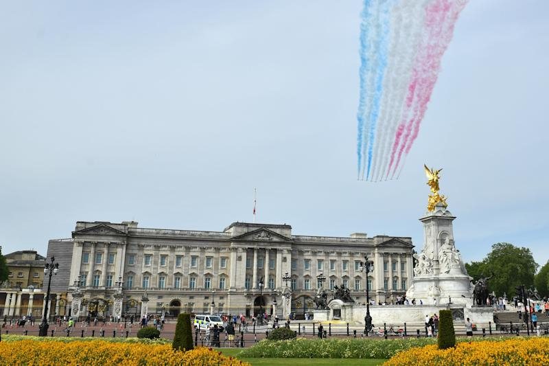The Royal Air Force Red Arrows pass over Buckingham Palace in London during a flypast in central London to mark the 75th anniversary of VE Day. (Photo by Dominic Lipinski/PA Images via Getty Images)