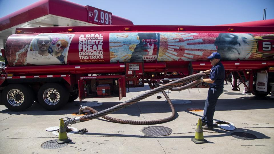A fuel tanker driver delivers a 9000 gallon load of fuel at the Sheetz in Raleigh, N.C., Thursday, May 13, 2021. Operators of the Colonial Pipeline say they began the process of moving fuel through the pipeline again on Wednesday, six days after it was shut down because of a cyberattack. (Travis Long/The News & Observer via AP)