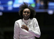 <p>Lauren Rembi of France reacts after losing a bronze medal fencing bout at Carioca Arena in Rio on August 6, 2016. (REUTERS/Issei Kato) </p>