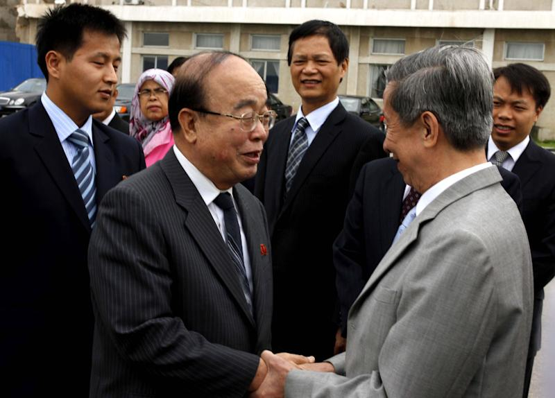 North Korean Foreign Minister Pak Ui Chun, second from left, shakes hands with Cambodian Ambassador to North Korea Chhorn Hay at Pyongyang airport, North Korea, Saturday, June 29, 2013 before leaving for Brunei to attend the ASEAN foreign ministers meeting. The regional security summit in Brunei is the sort of venue where North Korea has often managed to open up sideline discussions with Seoul and Washington. This time, while there will be plenty of talk about Pyongyang, there is little chance of substantive talk with it. (AP Photo/Kim Kwang Hyon)