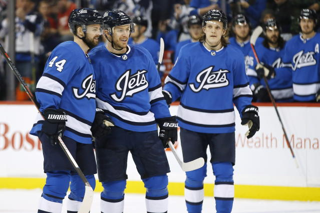 Winnipeg Jets' Josh Morrissey (44), Bryan Little (18) and Sami Niku (83) celebrate Little's goal against the Detroit Red Wings during the second period of an NHL hockey game Friday, Jan. 11, 2019, in Winnipeg, Manitoba. (John Woods/The Canadian Press via AP)