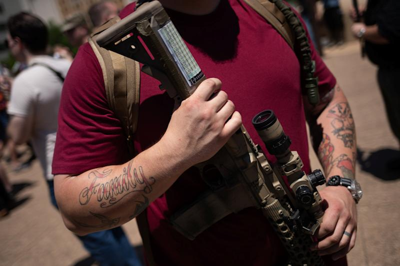 Man holds assult rifle during open carry firearm rally during NRA meeting in Dallas, Texas