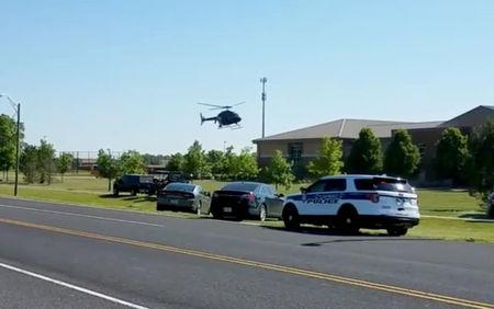 A helicopter lands near Noblesville West Middle School in Noblesville, Indiana, U.S., May 25, 2018 in this still image obtained from social media video. COURTESY CHRISTOPHER REILY/via REUTERS
