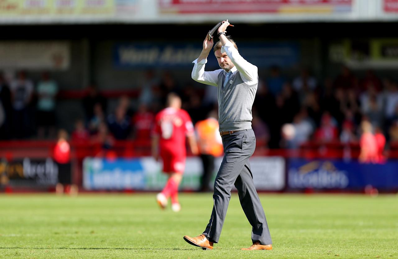 Coventry City's manager Steven Pressley applauds the away fans at the end of the match during the Sky Bet League One match at Broadfield Stadium, Crawley.