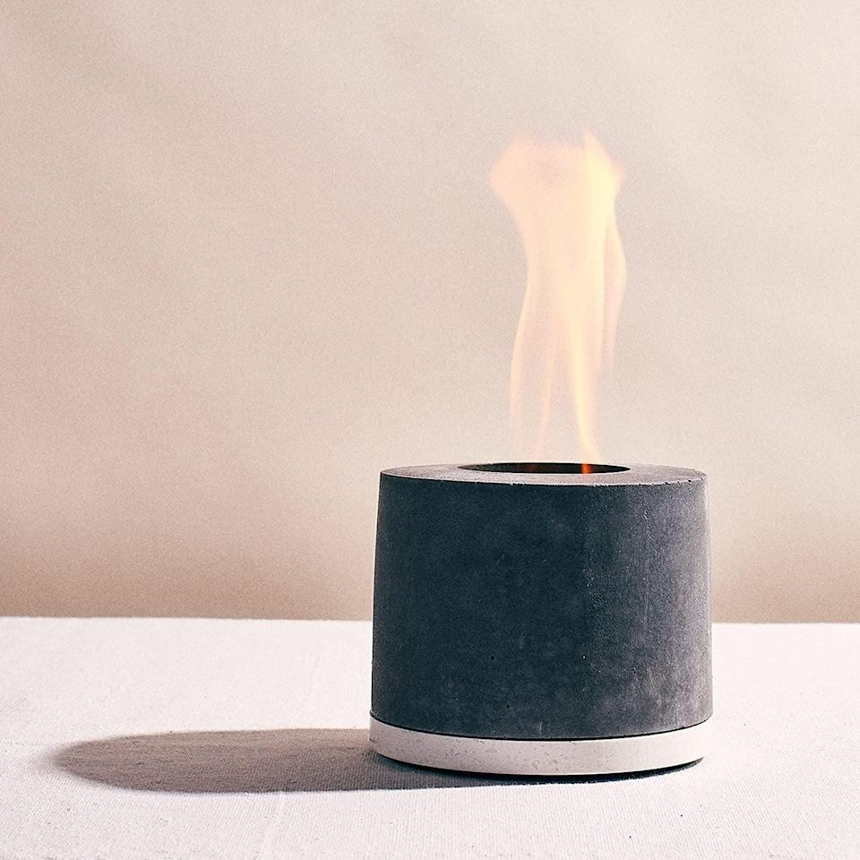 <p>Create yummy s'mores indoors or stay warm during the brisk summer night with this personal <span>FLÎKR Fire - The Original Isopropyl Alcohol Personal Fireplace</span> ($95).</p>