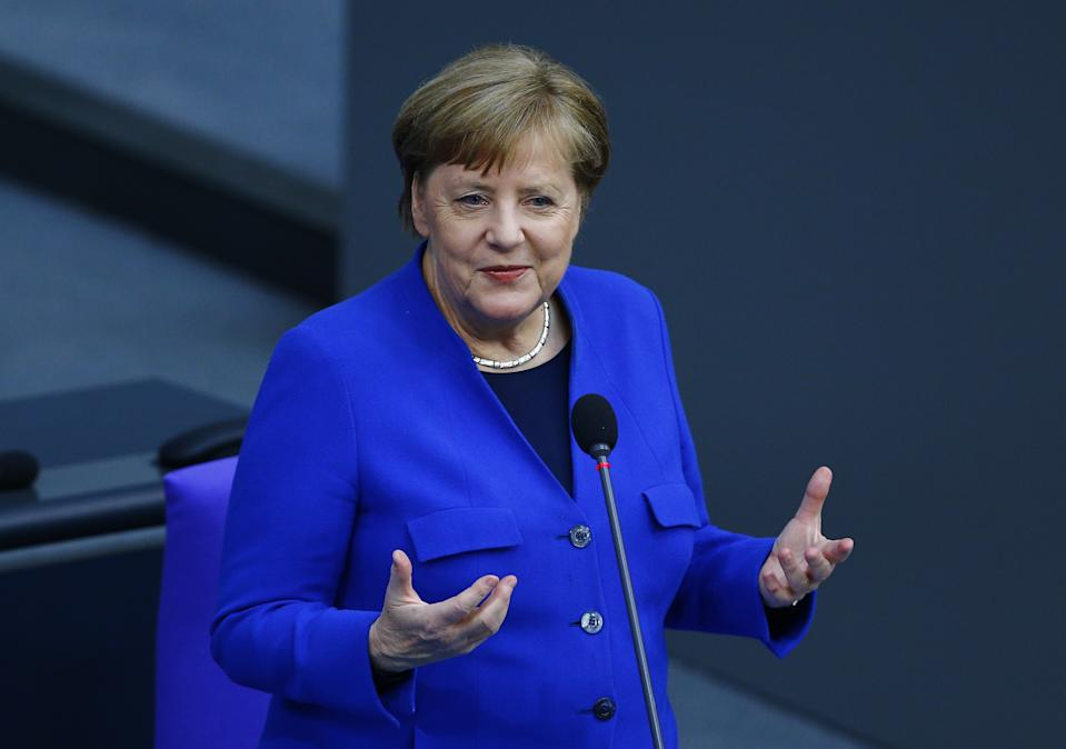 BERLIN, GERMANY - MAY 13: German Chancellor Angela Merkel speaks during a session held with the members of parliament on precautions to combat the novel coronavirus (COVID-19) and loosening the measures at the Bundestag Germany's parliament in Berlin, Germany, on May 13, 2020. (Photo by Abdulhamid Hosbas/Anadolu Agency via Getty Images)
