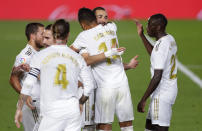 Real Madrid's Karim Benzema, second from right, celebrates with his teammates after scoring his side's opening goal during the Spanish La Liga soccer match between Real Madrid and Valencia at Alfredo di Stefano stadium in Madrid, Spain, Thursday, June 18, 2020. (AP Photo/Manu Fernandez)