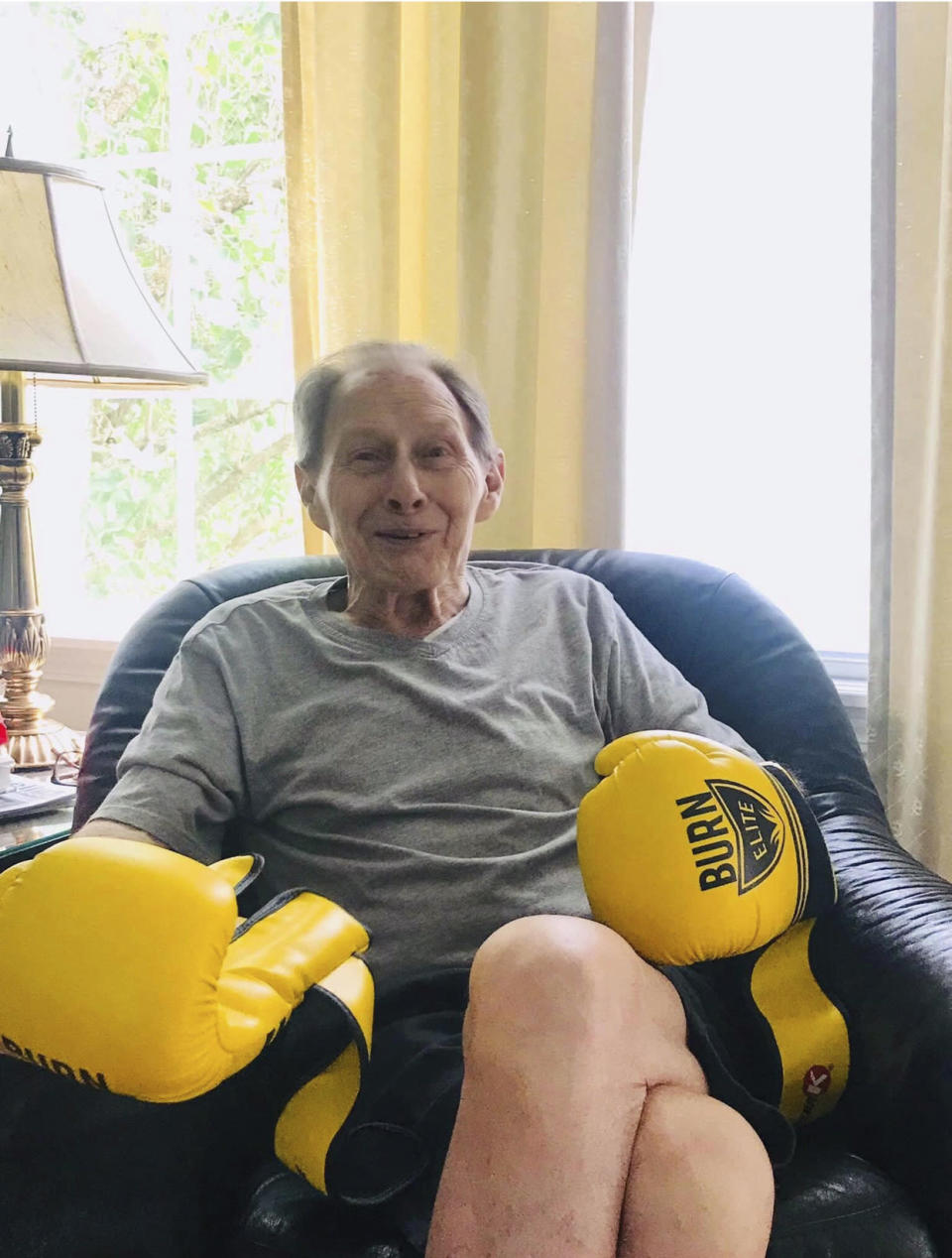 This Aug. 20, 2018 photo provided by Natalie Walters shows her father, Jack Walters, at his home in Syracuse, N.Y. Jack, who was staying at the Loretto Health and Rehabilitation nursing home in Syracuse, died of COVID-19 in December 2020. The facility's staffing has declined during the pandemic and Natalie wonders if poor staffing played a role in her father's infection or death. (Natalie Walters via AP)