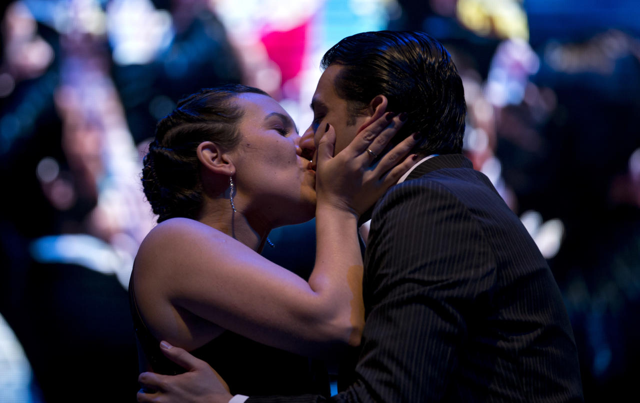 Argentina's dancers Facundo de la Cruz Gomez Palavecino, right, and Paola Sanz kiss as they celebrate after winning the 2012 Tango Dance World Cup salon finals in Buenos Aires, Argentina, Monday, Aug. 27, 2012. Couples from around the world competed in the finals Argentina's annual tango competition, the highlight of a two-week festival which this year honored Astor Piazzolla, the legendary composer and bandoneonista who revived the genre and infuriated purists by blending tango with rock music in the 1970s. (AP Photo/Natacha Pisarenko)