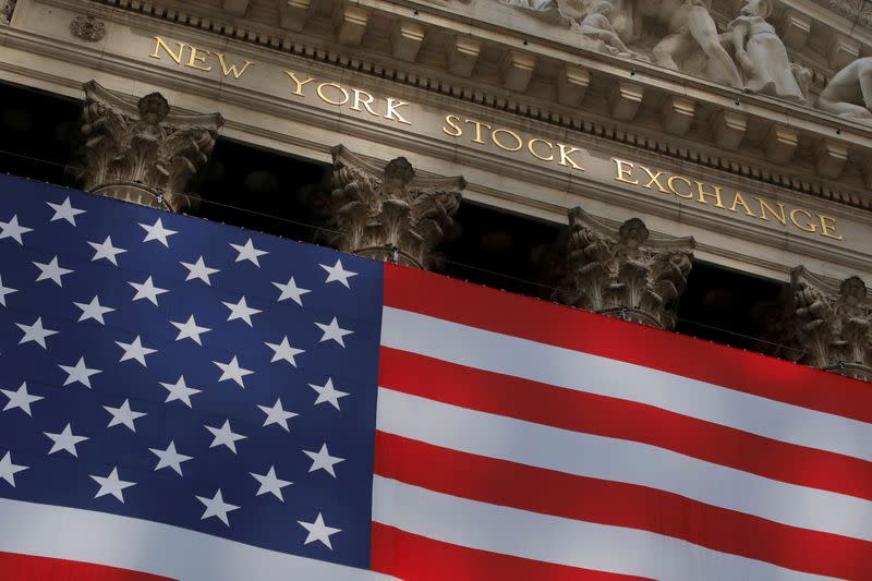FILE PHOTO: The U.S. flag is seen outside of the New York Stock Exchange (NYSE) in New York City