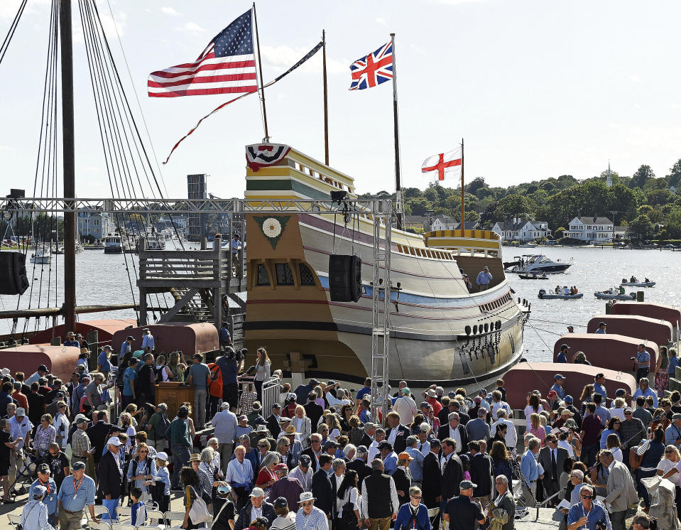 FILE- In this Sept. 7, 2019 file photo, guests come forward to see the Mayflower II afloat after a re-launch ceremony at the Mystic Seaport in Mystic Conn. After undergoing more than three years of major renovations in Connecticut and months of delays due to the COVID-19 pandemic, the replica of the Mayflower is ready to return home. (Sean D. Elliot/The Day via AP)