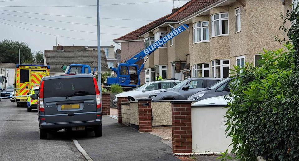 A crane on Springleaze in Mangotsfield, Bristol, where a man in his 70s was killed after being hit by a heavy load. (BPM Media)