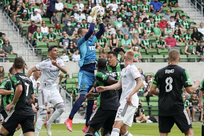 Austin FC goalkeeper Brad Stuver (41) makes a save against the Real Salt Lake during the first half of an MLS soccer match in Austin, Texas, Saturday, Oct. 2, 2021. (AP Photo/Chuck Burton)