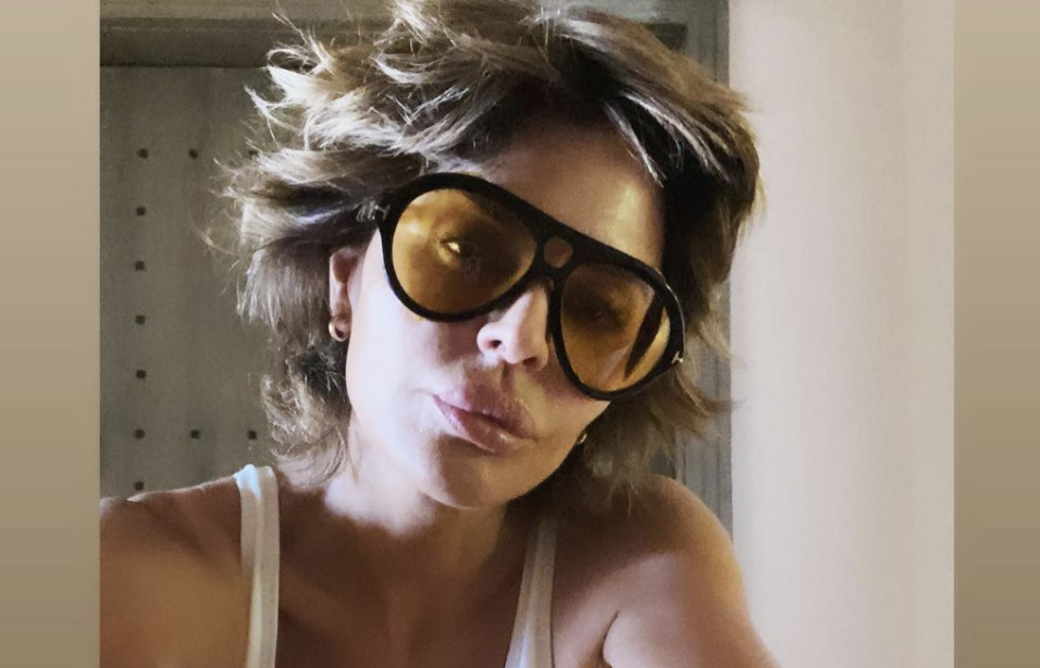 Lisa Rinna poses in white swimsuit in a belated-birthday post on Instagram. (Instagram)